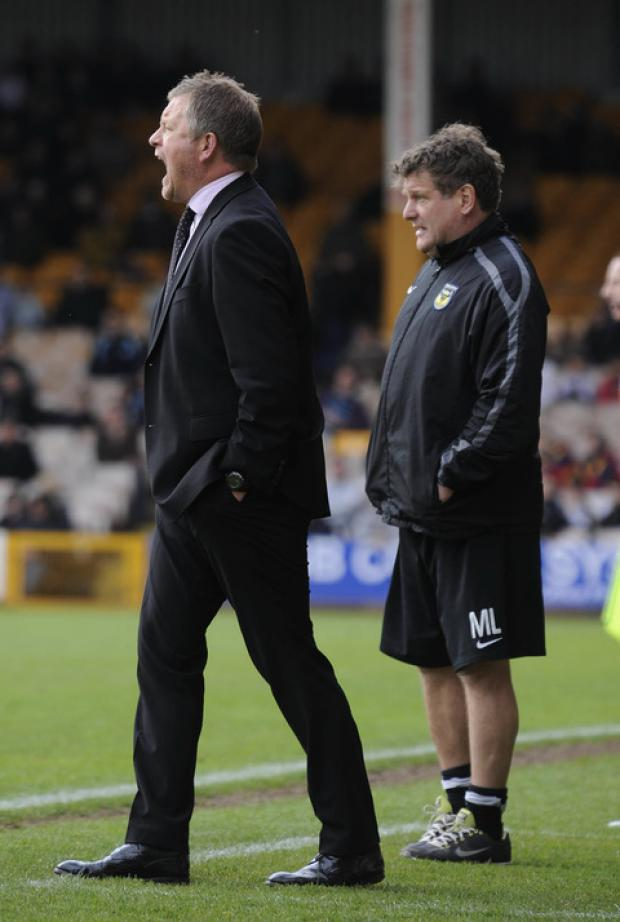 Oxford Mail: Boss Chris Wilder and assistant Mickey Lewis give instructions