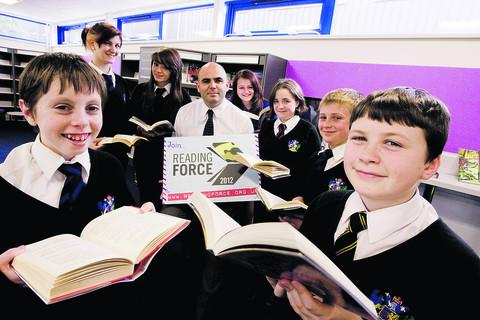 Carterton Community College teacher Chris Davies with, front from left, Aaron Debney, 13, and Jake Burns, 12, and, back from left, Aimee Felstead, 15, Megan Rockett, 14, Rachel Walker, 13, Lauren Full, 13, and Dawson Wall, 13