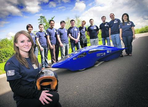 Driver Lucy Mahoney with Peggie and the team of Oxford students who created the battery-powered eco-car