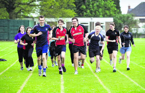 Teacher Toby Watkins and fellow runners from Batholemew School
