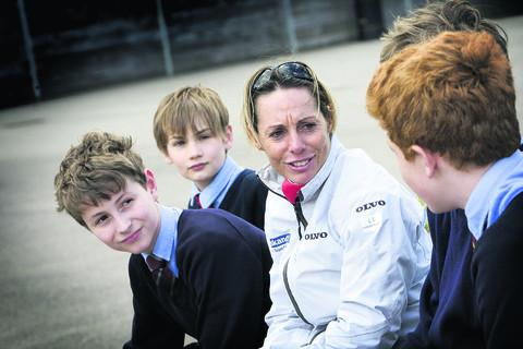 Paralympic sailor, Helena Lucas, chats with pupils, left to right, Jasper Simpson-Orlebar, 12; Freddie Hodge, 13; George Reid, 13 and Ben Fletcher, 13