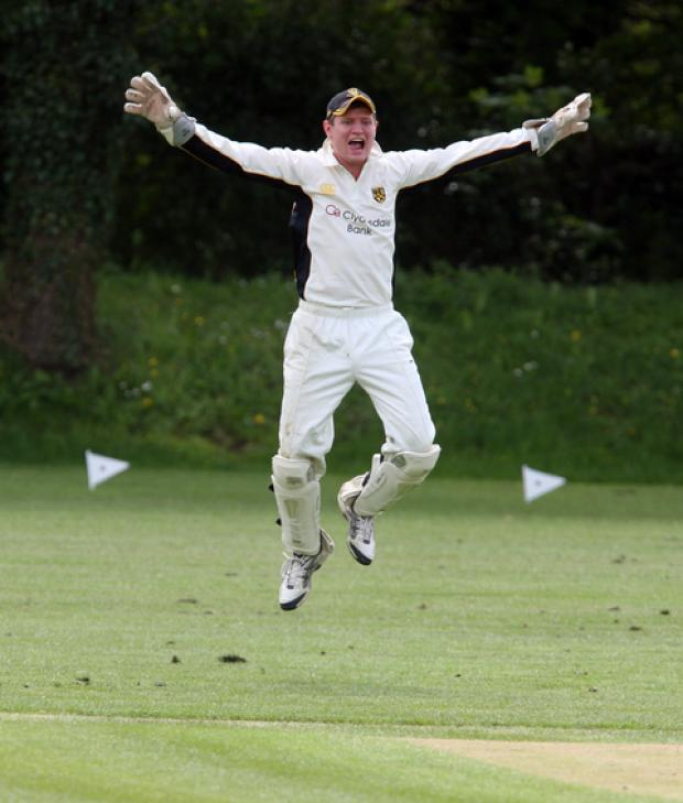 Cumnor wicket-keeper Matthew Lake celebrates after Oxford Downs captain Darryl Woods is given out lbw