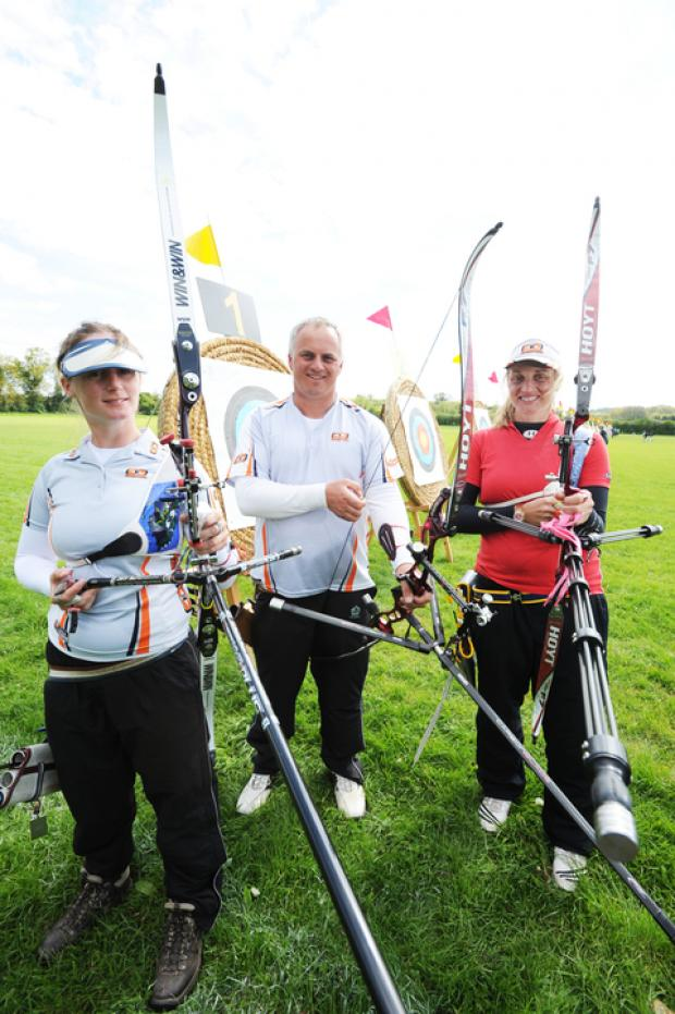 Team GB London 2012 archers (from left) Naomi Folkard, Simon Terry and Alison Williamson pose at Oxford RFC