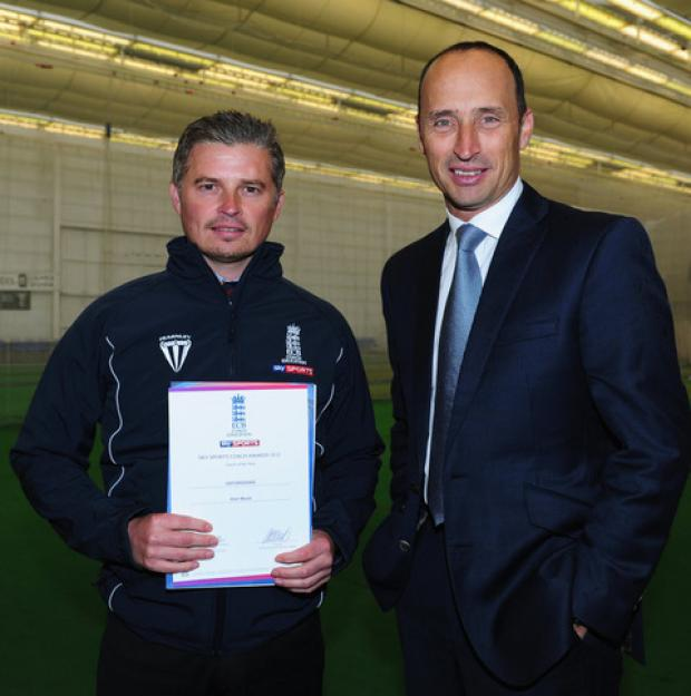 Alan Maule is presented with a special coaching certificate by ex-England captain Nasser Hussain