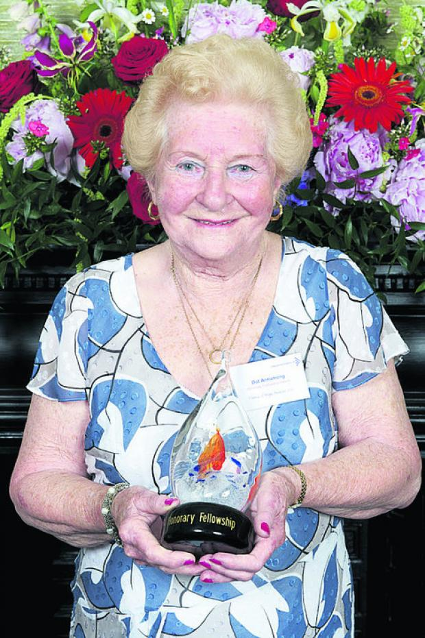 Dot Armstrong with her award