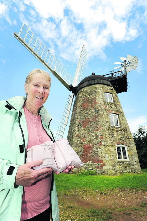 Mavis Ramsden holds some of the flour produced by the windmill