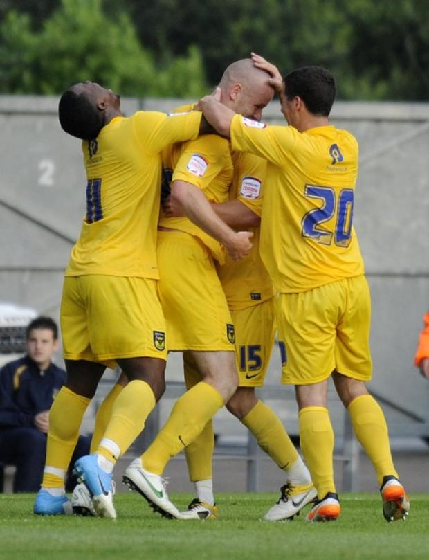 Deane Smalley (centre) receives the congratulations of his Oxford United teammates after smashing the winner in the 1-0 friendly victory over West Ham
