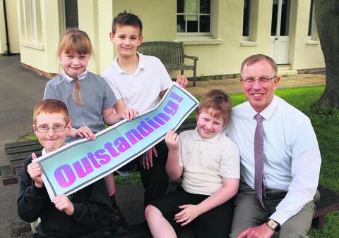 Headteacher Ian Barker is pictured with from left to right Kieran Pease, Sinead Hourigan, Zach Woodcock and Luke Fletcher