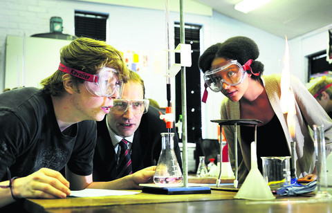 The Cherwell School headteacher Paul James, centre, with A-Level chemistry students Miriam Laird, 17, and Francis Riddell, 18