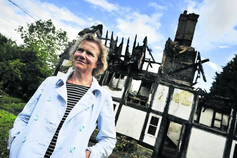 Pat Gilgrass at her burnt-out cottage in Sutton. Picture: Mark Hemsworth