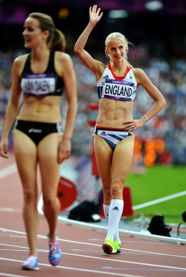 Hannah England salutes the fans after reaching the 1,500m semi-final