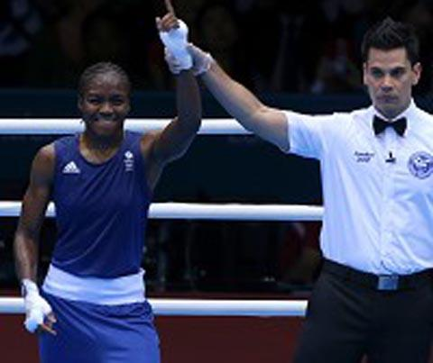 Nicola Adams celebrates reaching the final