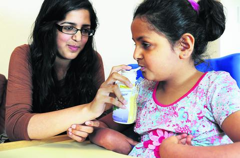 Nawaal Iqbal, 16, who cares for her nine-year-old sister Zara, got seven A*s, three As and one B in her GCSEs
