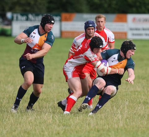 Oxford Harlequins' Alex Powell is tackled during their 49-14 home defeat to Barnstaple