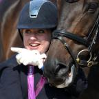 Oxford Mail: Golden girl Natasha Baker poses with her horse, Cabral