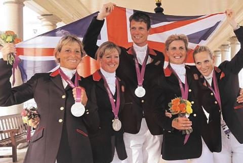Mary King, Nicola Wilson, William Fox-Pitt, Tina Cook and Zara Phillips celebrate their silver medal at the Olympics. The last-named four riders will all be in action at Blenhem this week