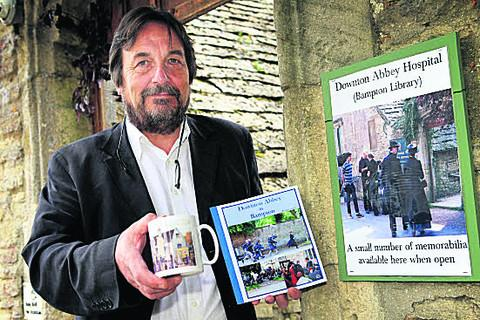 Robin Shuckburgh, chairman of Bampton Archive, with some memorabilia which is on sale in the village