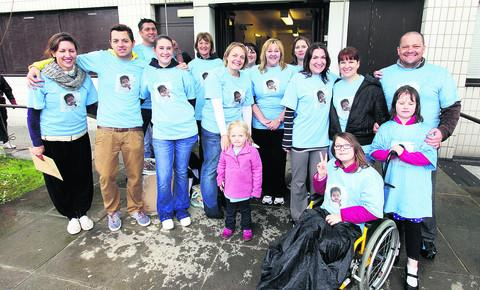 Emma Radley, centre, with daughter Eva and friends and family at the charity abseil in memory of William
