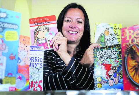Clare Bolton of the National Literacy Trust with her selection of children's books