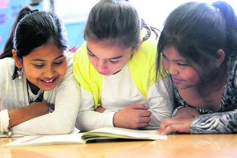 From left, Shanaz Ali, Martina Lukacsova and Bushra Begum-Miah reading at St Ebbes Primary School, Oxford