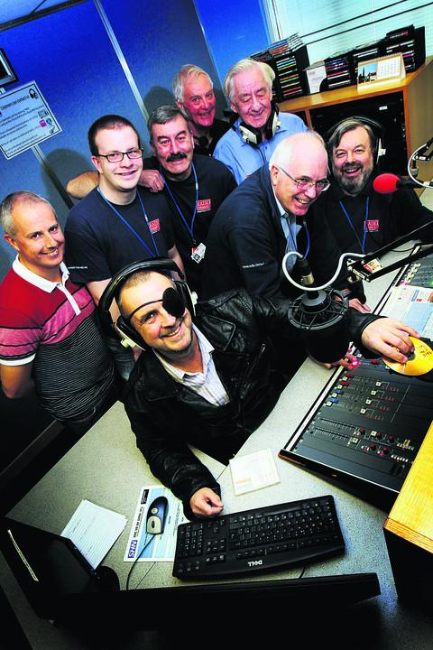 Radio Cherwell's Bruce Shakespeare, front left, Neil Stockton, front centre, and other Radio Cherwell staff celebrate their 45th anniversary