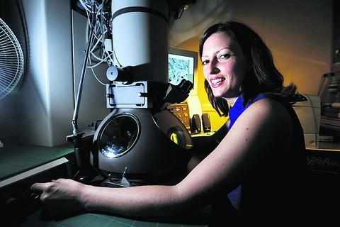 Dr Megan Dowie with the electron microscope