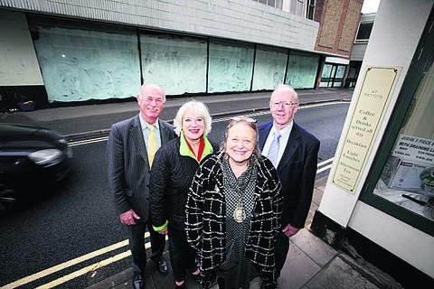 Town clerk Andrew Rogers, Elaine Hornsby, mayor, Ros Lester and town councillor Bernard Stone outside the former Waitrose store they are desperate to see redeveloped