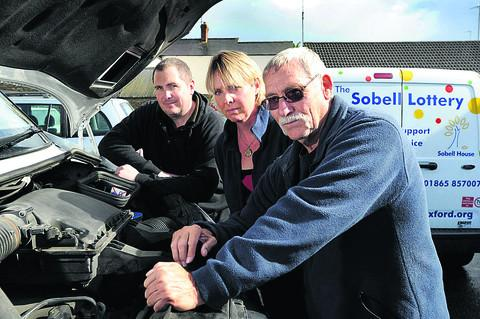 Oxford Mail: From left, Mark Gower, of Spires Auto Centre, Louise Musgrove, Sobell's trading manager, and Michael Barrett, the charity's warehouse manager
