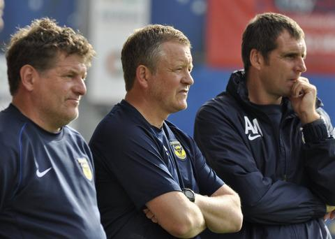 Oxford United's coaching team of Mickey Lewis, Chris Wilder and Andy Melville deep in thought during their side's poor run
