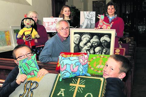 Pictured back from left with exhibits are Rita Brown, Gillian Armitstead, the Rev Armitstead, centre Andy Walton and, front, Connor Temple, left, and Archie Dix