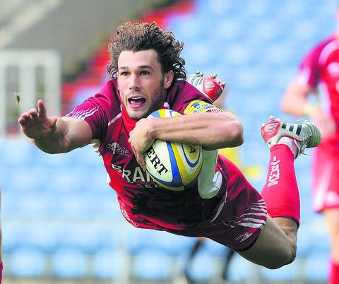 Tom Arnscott dives over for a spectacular try for London Welsh at the Kassam Stadium