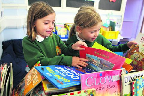 Freya Garton and Hanna Horbury look through the books at Windmill Primary School