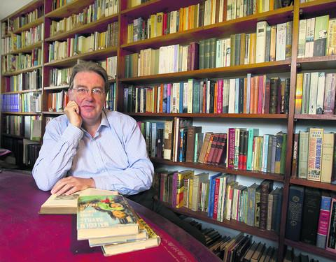 John Howell MP with some of the 4,000 books at his Warborough home