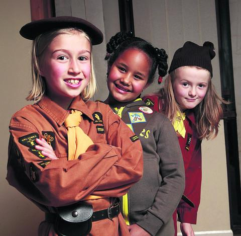 6th Oxford Brownies, from left, Alexia Roberts, nine, in the 1934-66 uniform, Kazmin Vincent, seven, in current uniform, and Ruby Crocker, seven, in the 67-90 uniform