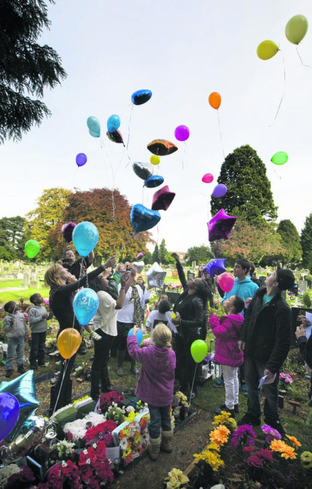 Up and away: Dozens of balloons are released for Aaron Buron