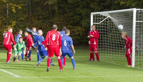 Enstone Sports' keeper Danny Phillips is well-beaten by a near post header from a corner, but Mark Clements saves the day as he heads off the line in their 2-0 home defeat by Northway in Division 1