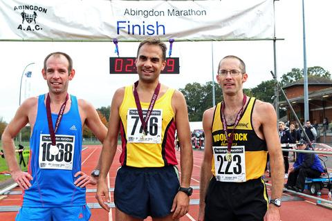 Abingdon Marathon winner Paul Fernandez is flanked by Mark Greenwood (left) and James Bolton