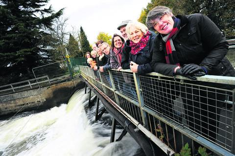 Pictured at the weir at Osney Lock, are, front, from right, Barbara Hammond, director of West Oxford Community Renewables, Sue Brayne, Tim Kiggell and Saskya Huggins with supporters of the campaign
