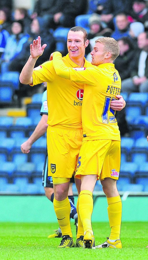 United striker James Constable (left) celebrates his first league goal since February with Alfie Potter
