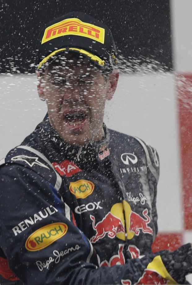 Sebastian Vettel is sprayed with champage after his win in the Indian GP took him nearer another world title