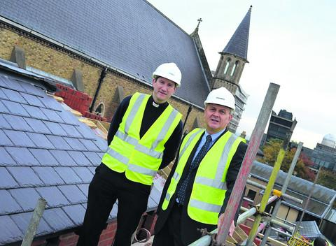Oxford Mail: Father Daniel Seward, left, and project manager Peter McDonald review building progress on the new accommodation block at the Oxford Oratory in Woodstock Road