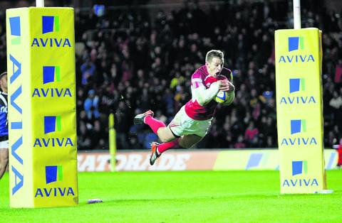 Nick Scott dives over for the winning try