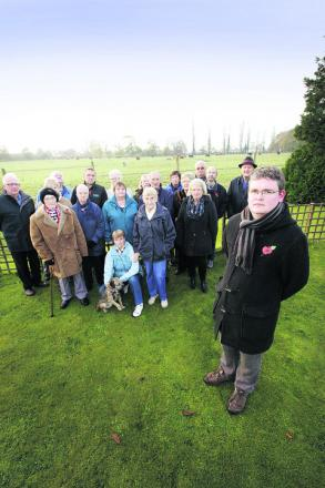 Cllr Aidan Melville, right, with residents of Virginia Way, Abingdon, who are opposed to plans for 160 new homes. Picture: OX55373 Damian Halliwell