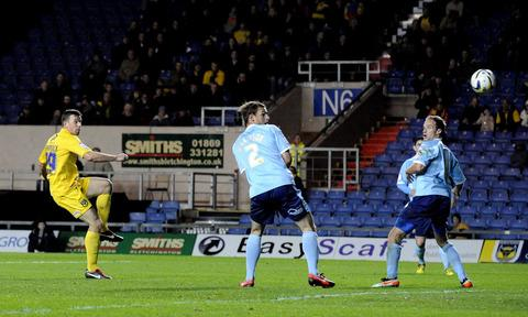 Tom Craddock fires home the first of his two goals to get Oxford United back in the game, but it wasn't enough as ten-man Dagenham triumphed 3-2