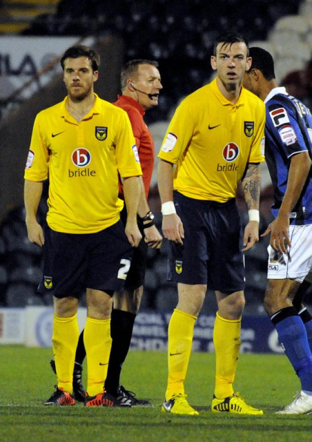 Oxford Mail: Centre back Michael Raynes (right) was preferred over Johnny Mullins (left) by Oxford United manager Chris Wilder against Dagenham & Redbridge