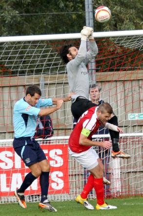 Didcot Town keeper Marcos Belloli-Pereira returns for tomorrow's third qualifying round against Dorchester Town at the npower Loop Meadow Stadium