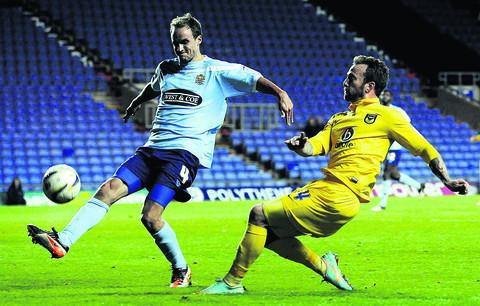 Oxford Mail: Sean Rigg gets a cross in against Dagenham & Redbridge  Picture: David Fleming