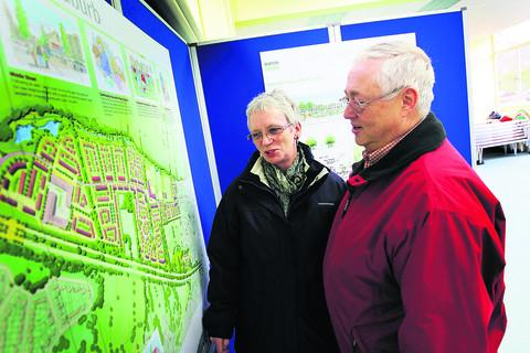 Maureen and Peter Sinnott look at the plans for the Barton West development