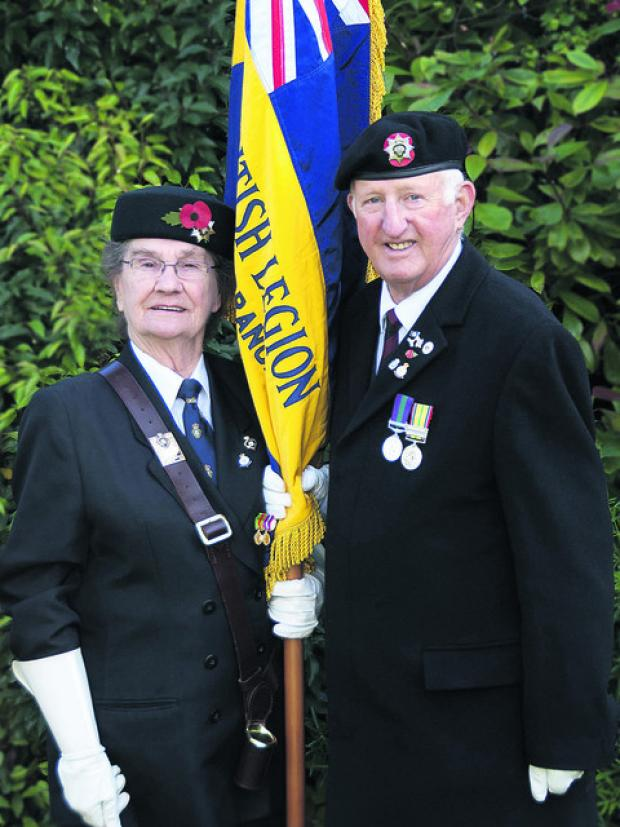 Jane Leigh, 88, is passing over the task of carrying the Didcot RBL standard to former serviceman Peter Ryding after performing the duty for more than 20 years