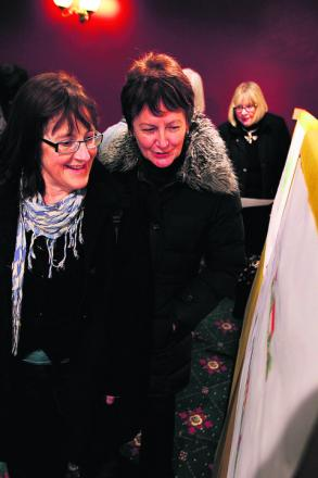 Georgina Timbs, right, and Lesley Brown look at the plans